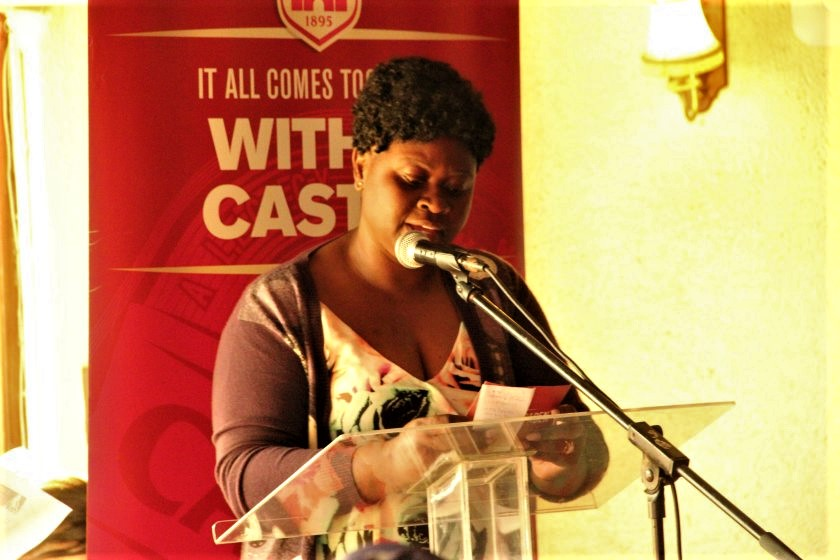 Delta marketing manager, Patricia Murambinda reads out the name of one of the winners.