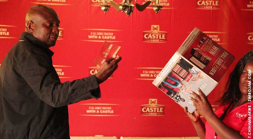 Delta national sales head, Mr. Muchenje picking out a winning entry.