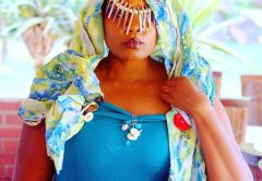 .R. looks mysterious in dress by Sabina Mutsvati.