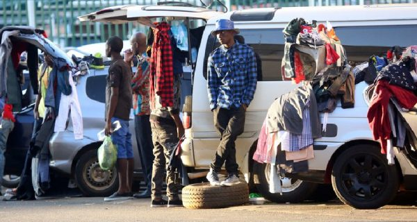 """Vendors at """"Ximex"""" selling products off the back of thier car. PIC: COURTESY OF NEWSVYB.COM"""