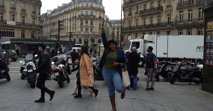 Rutendo high-fives Paris.