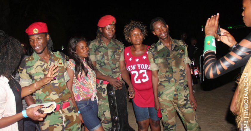 Fan club... Baba Harare (left) with other New Generation band members and fans. PIC: T. NDABAMBI