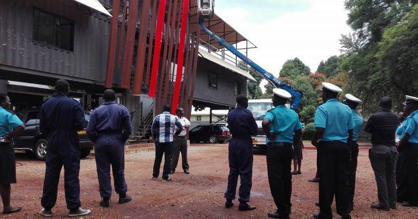 Harare City Council officers attempt to tear down the containers at Moto Republik PIC: COURTESY OF HENRY OLIVER HAKULANDABA